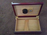 red and beige wood-framed jewelry case