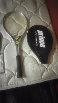 black and gray Wilson tennis racket with case 1467 mi