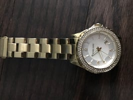 Round white michael kors analog watch with gold link
