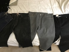 four black and gray denim jeans