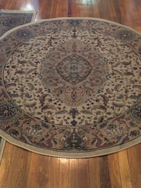 Round brown and black persian area rug