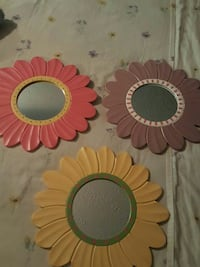 three assorted color floral mirror
