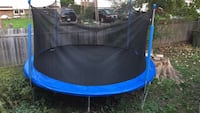 blue and black trampoline with enclosure Longueuil, J4V 1N8