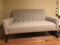 gray fabric tufted sofa with throw pillows