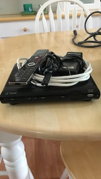 Black Telus multimedia player with remote