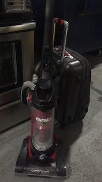 black and gray Eureka upright vacuum cleaner Toronto, M9A