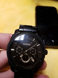 round black Fossil chronograph watch with black link bracelet