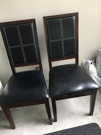 two black leather padded chairs 3750 km