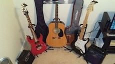 three guitars with two gig bags
