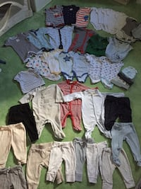 baby's assorted clothes null