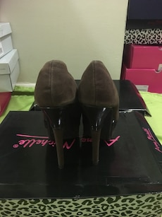 pair of brown leather pumps with box