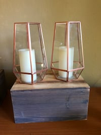 two white wooden framed mirrors