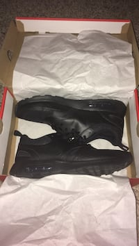 pair of black Nike Air Max shoes with box