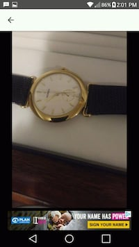 round gold-colored analog watch with black leather strap Brampton, L6X