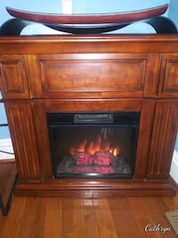 Electric fireplace with mahogany finished wood mantel and base. Baltimore, 21217
