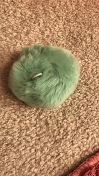 green and white fur cap