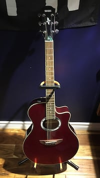 Red yamaha acoustic guitar with stand (all in amazing condition)