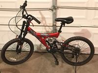 red and black full suspension mountain bike Columbia, 21044