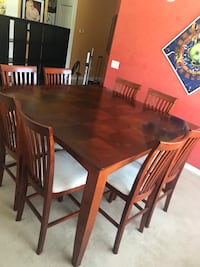 rectangular brown wooden table with six chairs dining set Land O Lakes, 34637