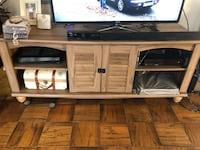 brown wooden TV stand with flat screen television Friendship Heights, 20815
