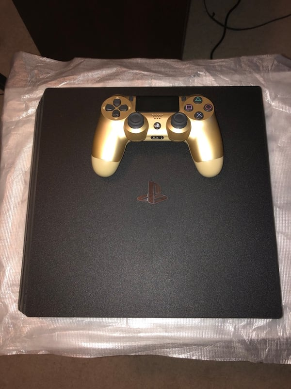 PS4 PRO 1TB FOR SALE!!! Gold Dualshock 4, Games and Sony standard mic! 0c357ae2-d7b1-4bfb-b1c1-8aaeb2f1ae6e