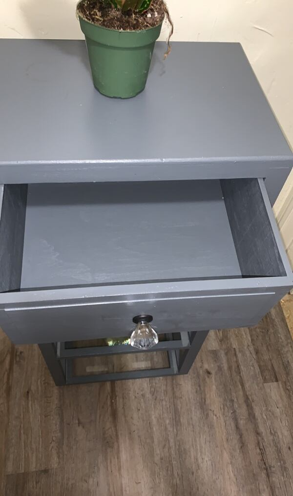 Rolling glass cabinet corner table  c46face0-694b-4923-a158-bbd8231048e6