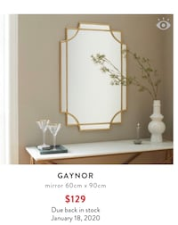 One remaining new gold wall mirror from Structube Calgary, T2E 0H4