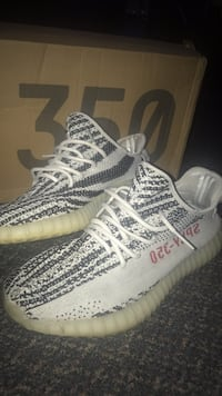 pair of Zebra Adidas Yeezy Boost 350 V2 3121 km