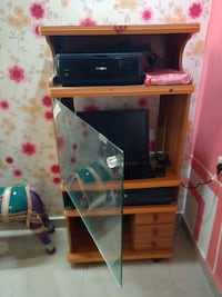 brown wooden framed glass top TV stand Hyderabad, 500089