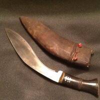 Black and brown handled knife