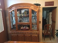 brown wooden framed glass display cabinet Palmdale