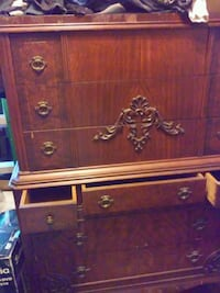 Antique bedroom bureau and high dresser with mounted round mirror fram