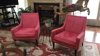 two coral pink suede chairs