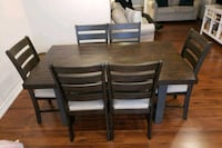 rectangular brown wooden table with four chairs di Thorold, L2V 0A6