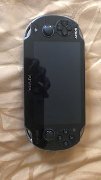black Sony PSP with game cartridge Silver Spring, 20905