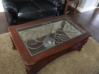 brown wooden framed glass top coffee table Surrey, V3W