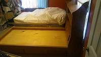 2 twin bed frames with drawers