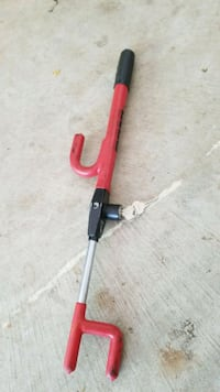 red and black vehicle steering wheel lock