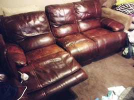 Brown couch with two built in reclinesr. Two marbl/wood end tables