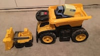 Yellow and black plastic dump truck toy