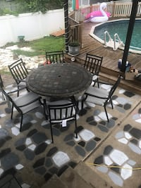 round black metal patio table with four chairs Temple, 19560