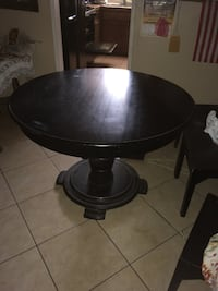 Round brown wooden pedestal table comes with 4 chairs Indio, 92201