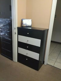 black and white wooden dresser with mirror