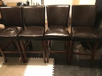 Four black leather padded chairs Burnaby, V5C 2S5