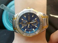 round gold-colored chronograph watch with link bra Winnipeg, R2Y 2J8