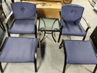 Two blue out door chairs with table and door rests Oklahoma City, 73162