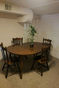 round brown wooden table with four chairs dining s Washington, 20019