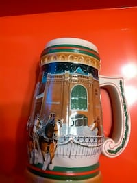 white, green, and red ceramic beer mug