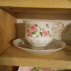 pink and white floral ceramic cup and saucer