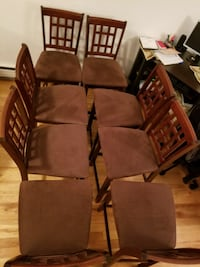 8 wooden armless high chairs in good conditions Montréal, H4M 2C3